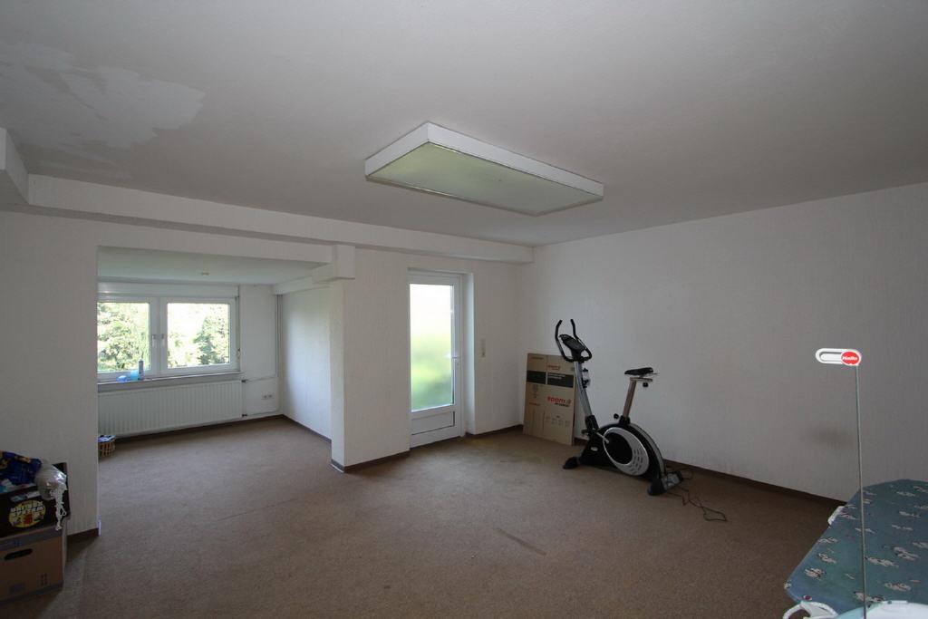 Arbeits- oder Hobbyraum mit Hauseingang